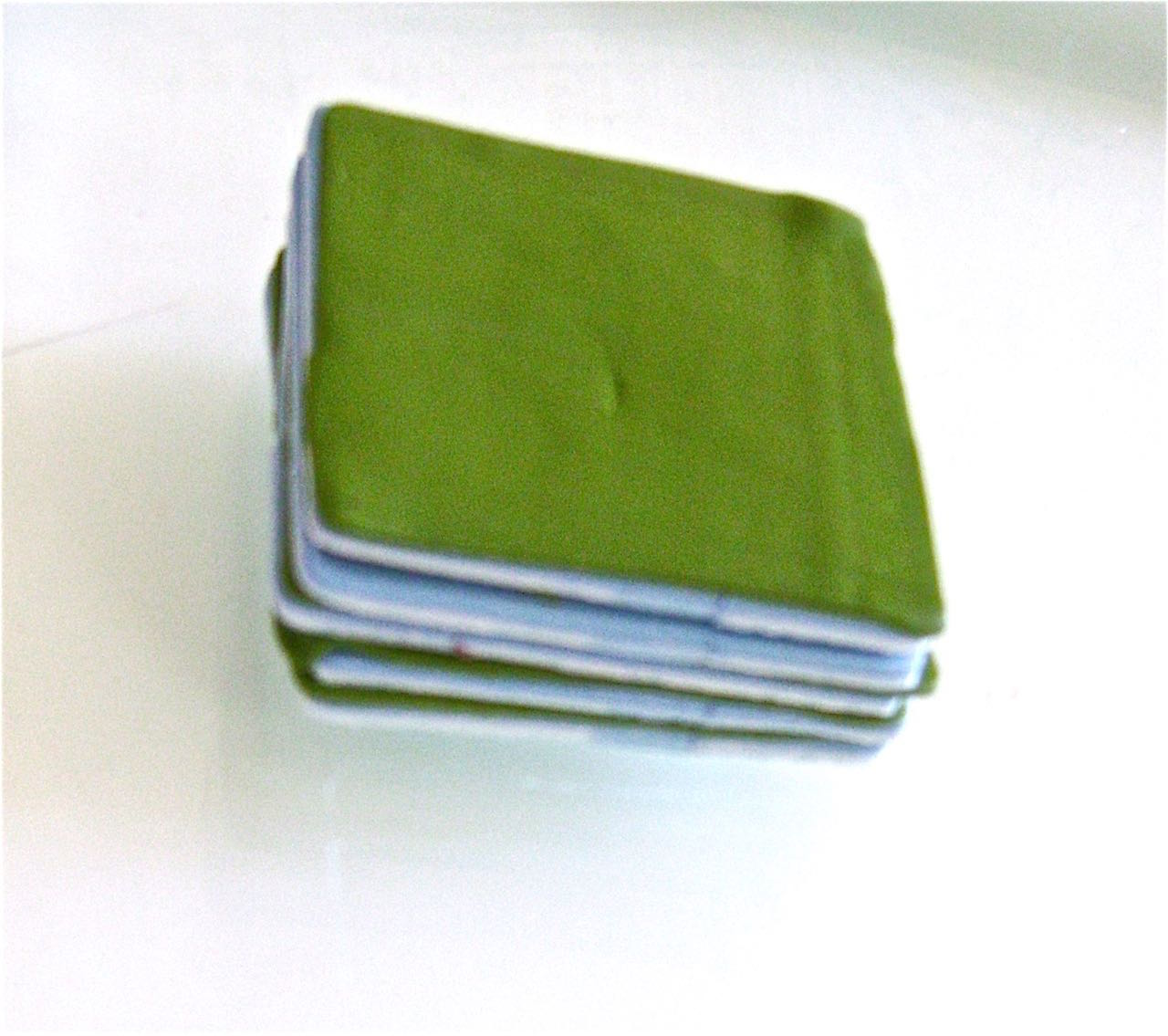 """step 1 - Condition about 2 oz. of each clay color. Use an acrylic roller or put it through a pasta machine to create layers that are the same thickness, about 1/16"""" or less. Use a cutter to make sheets the same dimension. Stack them with blue on the bottom, then green then plum. Alternate the colors until you have used up your sheets. This photo is not from this project but shows how to stack the clay."""