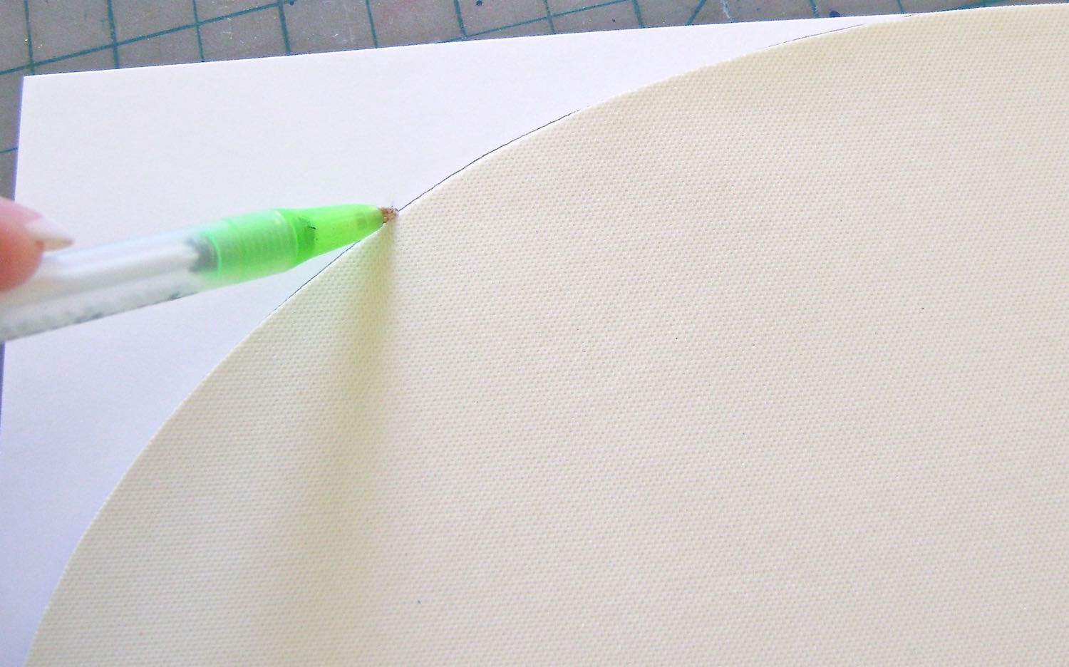 step 6 - Place the cut mat on pieced-together card stock.  Trace the curved edges of the mat to create a template.