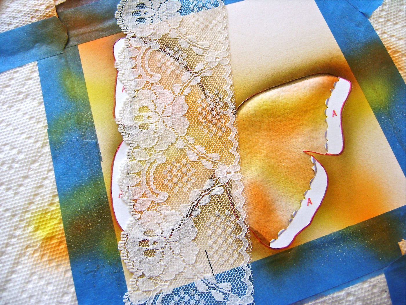 """step 10 - Set aside section """"B"""". Put the four section """"A""""s back in place. Position a decorative stencil or lace over one wing after applying adhesive to the back. Spray with Bronze Have More Fun paint to create designs inside the wings. Repeat on the other wing."""
