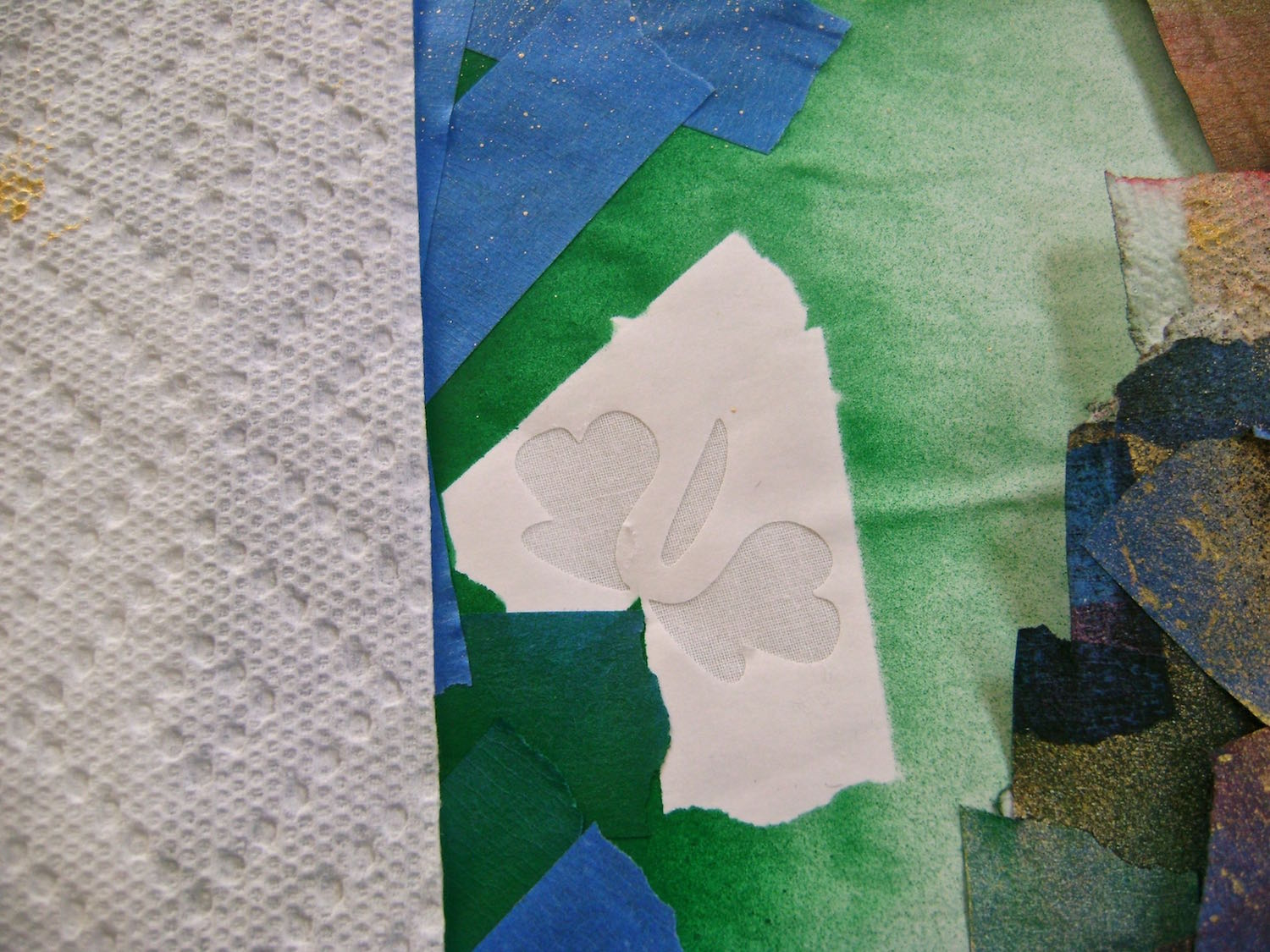 step 8 - Remove the tape from the flowers. Protect open green areas, then spray the flowers with Purple People Eater paint.  step 9 - When all the paint is dry, remove the tape and stencil.