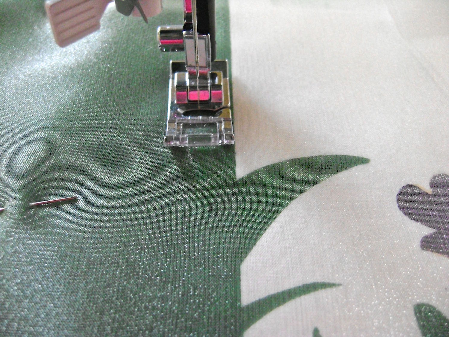 """step 11 - Sew the organza to the pillow front by stitching .25"""" from the vertical green edge."""