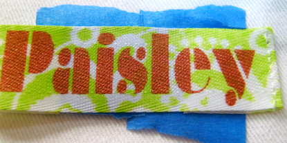step 6 - On the right side, stitch close to the edge of the fold on one end of the label.