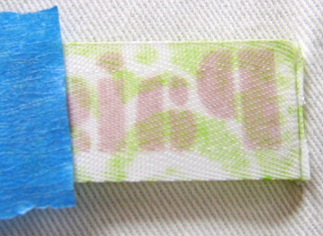 step 7 - Remove painters tape from the hemmed edge. Trim the excess material close to the stitching.