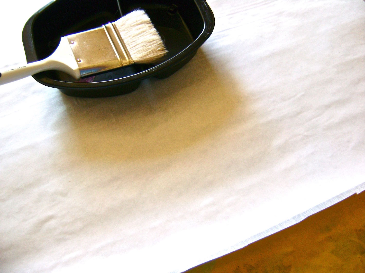 step 3 - With a bristle brush, apply a coat of Fast Finish Decoupage to the bonded fabric. This product will give the finished flower petals the body they need.