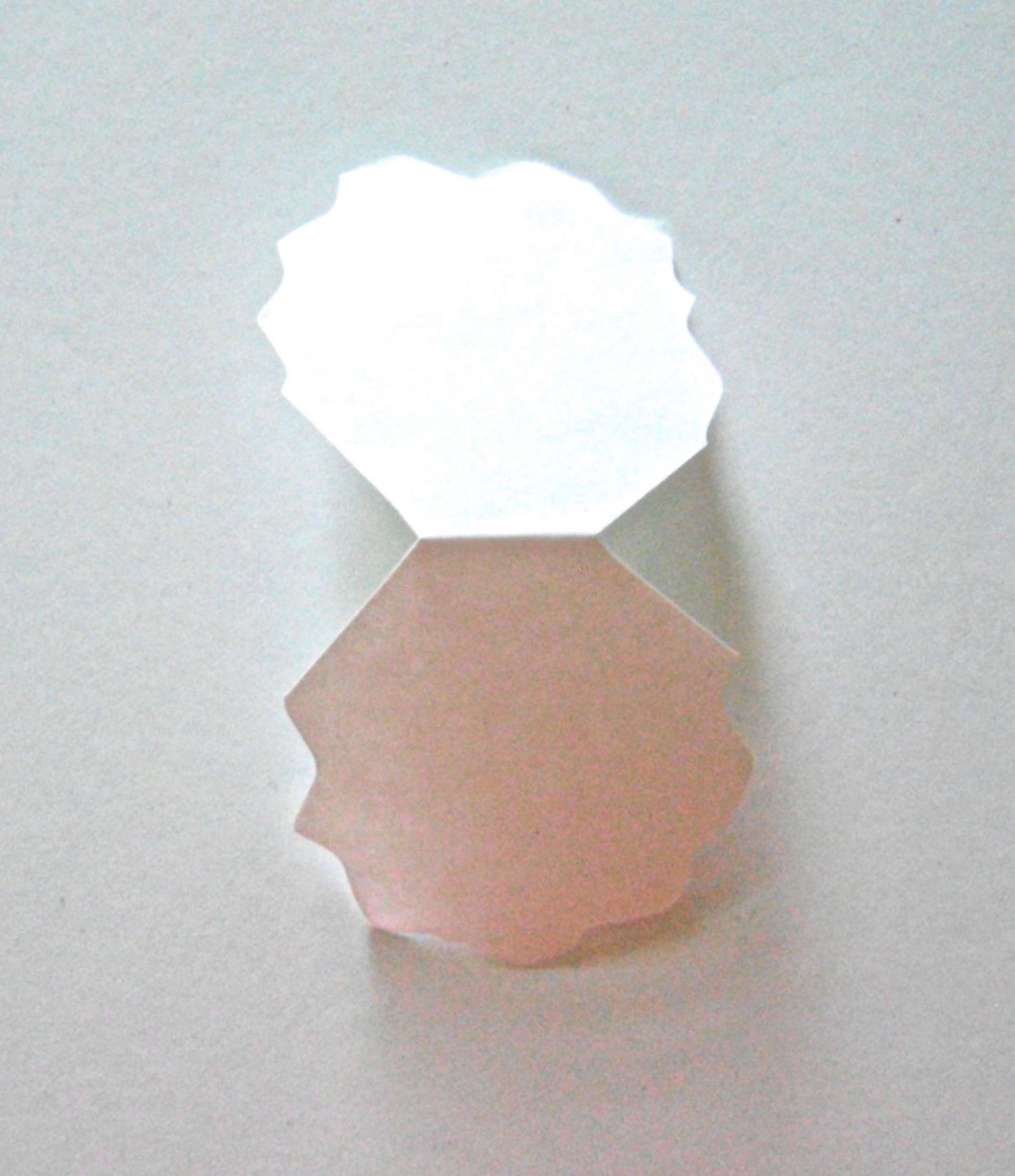 step 5 - Using a rotary cutter with a wavy blade, cut all the strips into the shapes provided in the template. Do not discard the the petal border pieces.