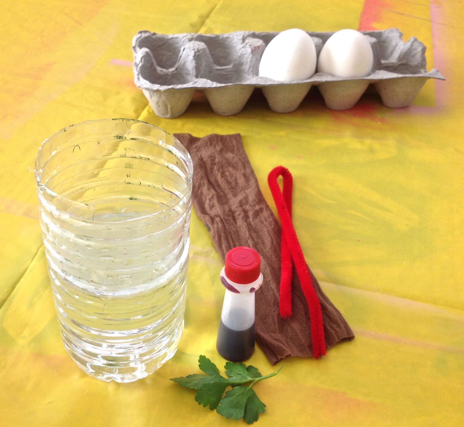DYING EGGS  Knee Highs, Water Bottles and Pipe Cleaners One very convenient way to decorate eggs with food color is to dunk them. I found some easy tools to use that keep your hands relatively dye-free and require little clean up.