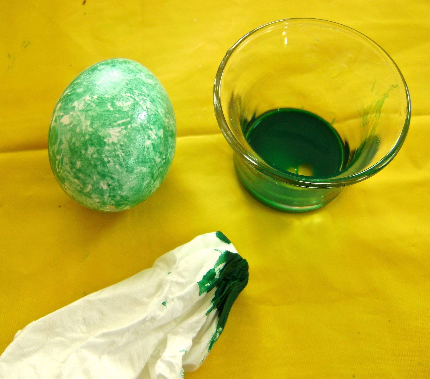 step 10 - Wad up a tissue and dip it in paint.  Dab it lightly on a paper towel to collect excess paint and avoid puddles on the egg.  Use the tissue to lightly dot color on the egg to create abstract designs.  But don't stop there!  Apply other colors in the same way on top of the first.