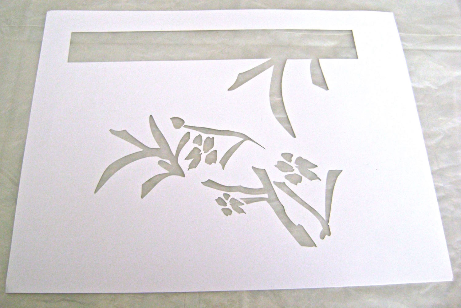 step 1 - Download and print out the flower and stem stencil on a label sheet. Cut out the stencil with a craft knife.