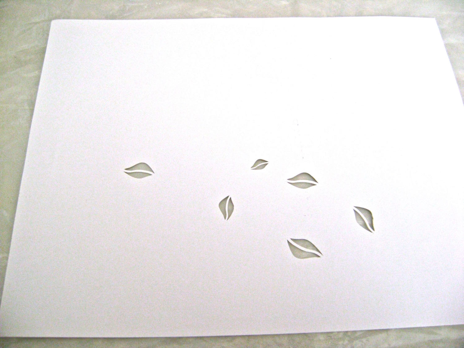 step 2 - Download and print out the leaf stencil on a label sheet. Cut out the stencil.