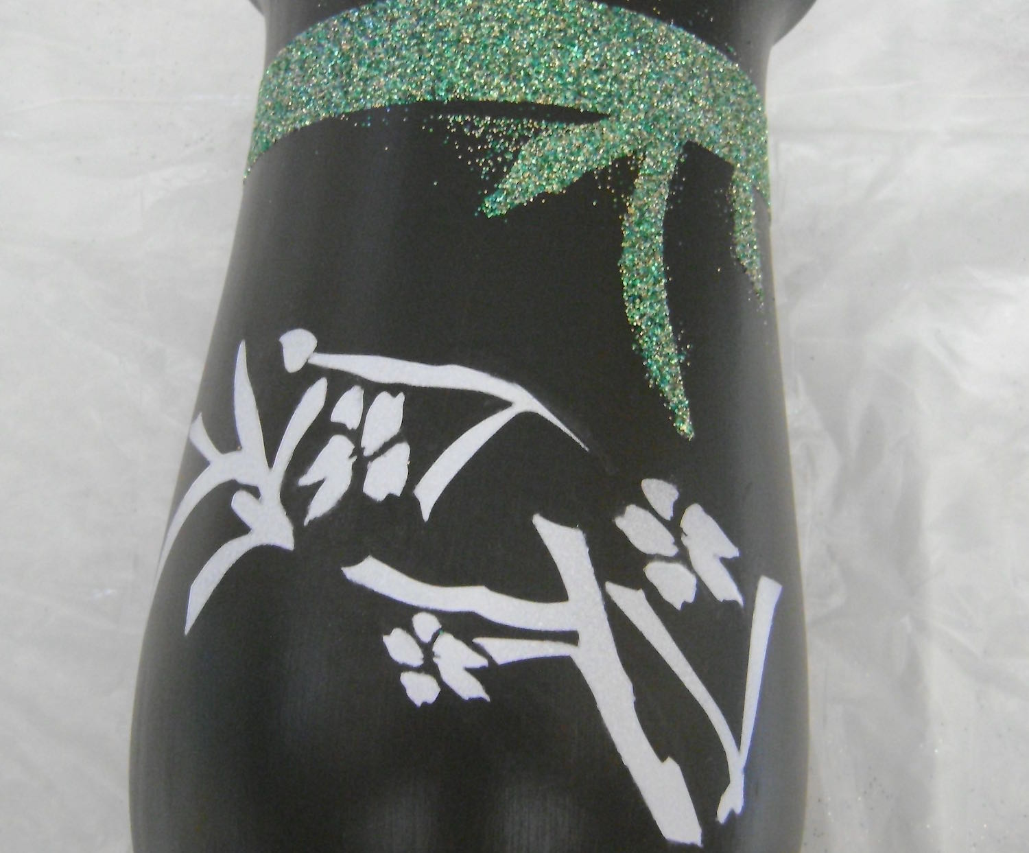 step 10 - Fill the airbrush with the White Pearl paint and spray the stencil.  When dry, remove the stencil from the vase.