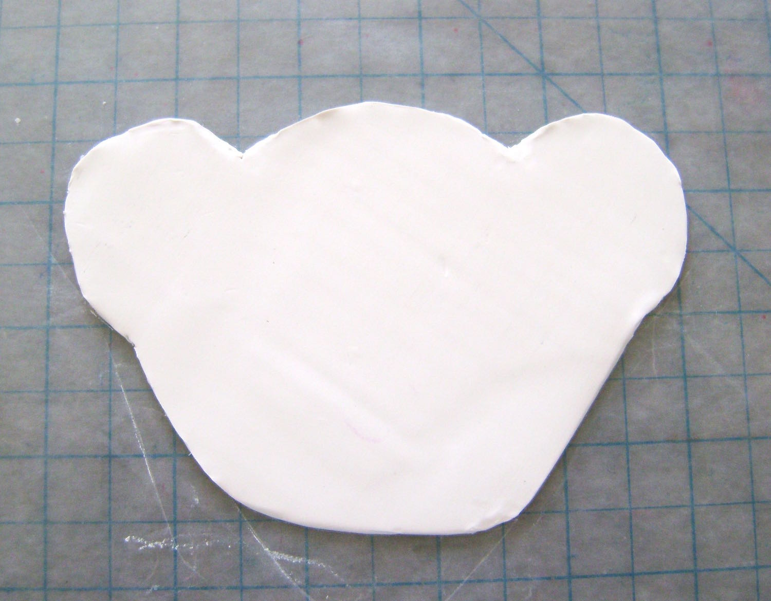 step 3 - Position the head template on the clay and cut it out using a craft knife. Cut out all the remaining pieces.