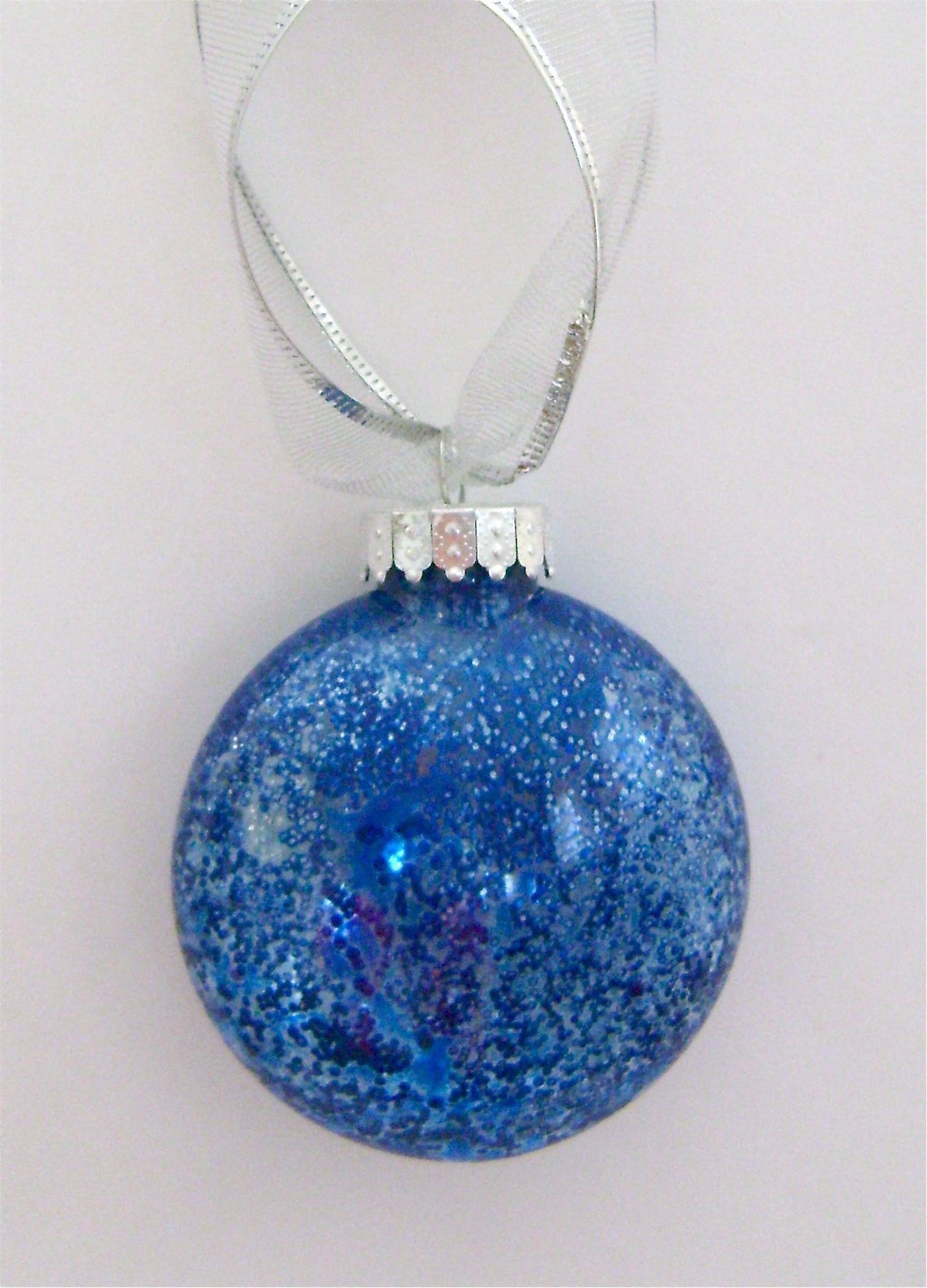 Blue Ornament   Apply blue paint.  When dry, quickly swish Fast Finish Decoupage around inside followed by a heavy sprinkle of fine silver glitter.