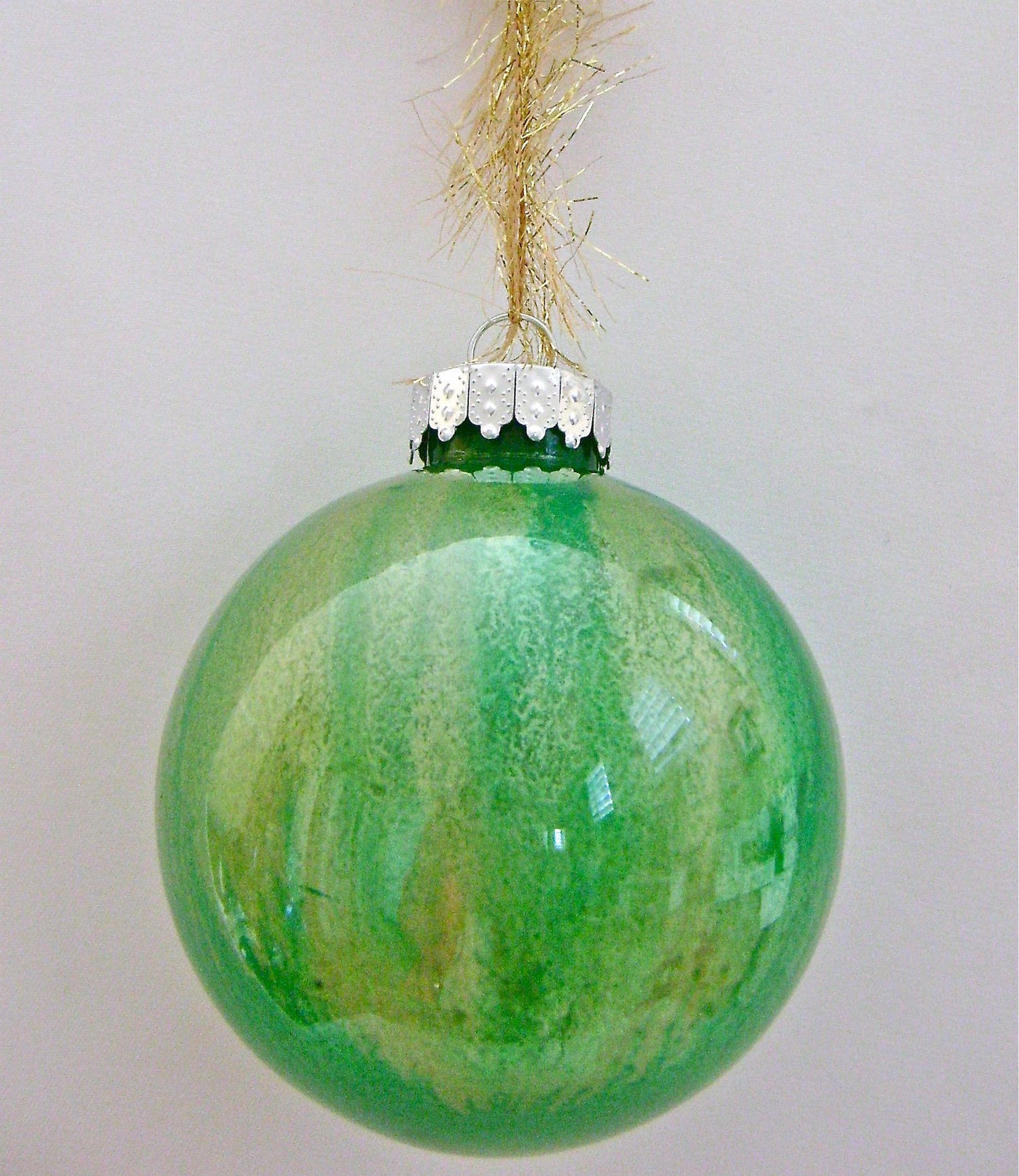 Green Ornament   Apply equal portions of green followed by gold paint.