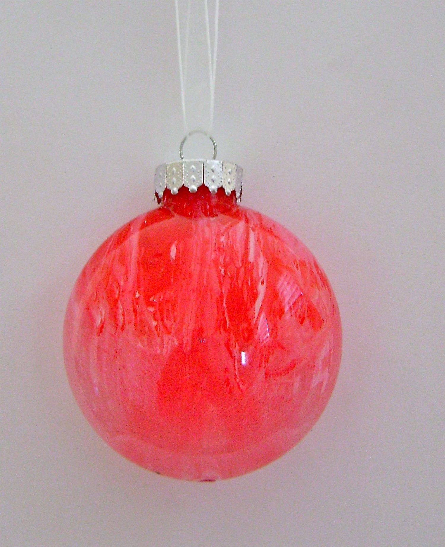 Red Ornament   Apply red paint.  Allow the red paint to dry almost completely.  Apply white paint.