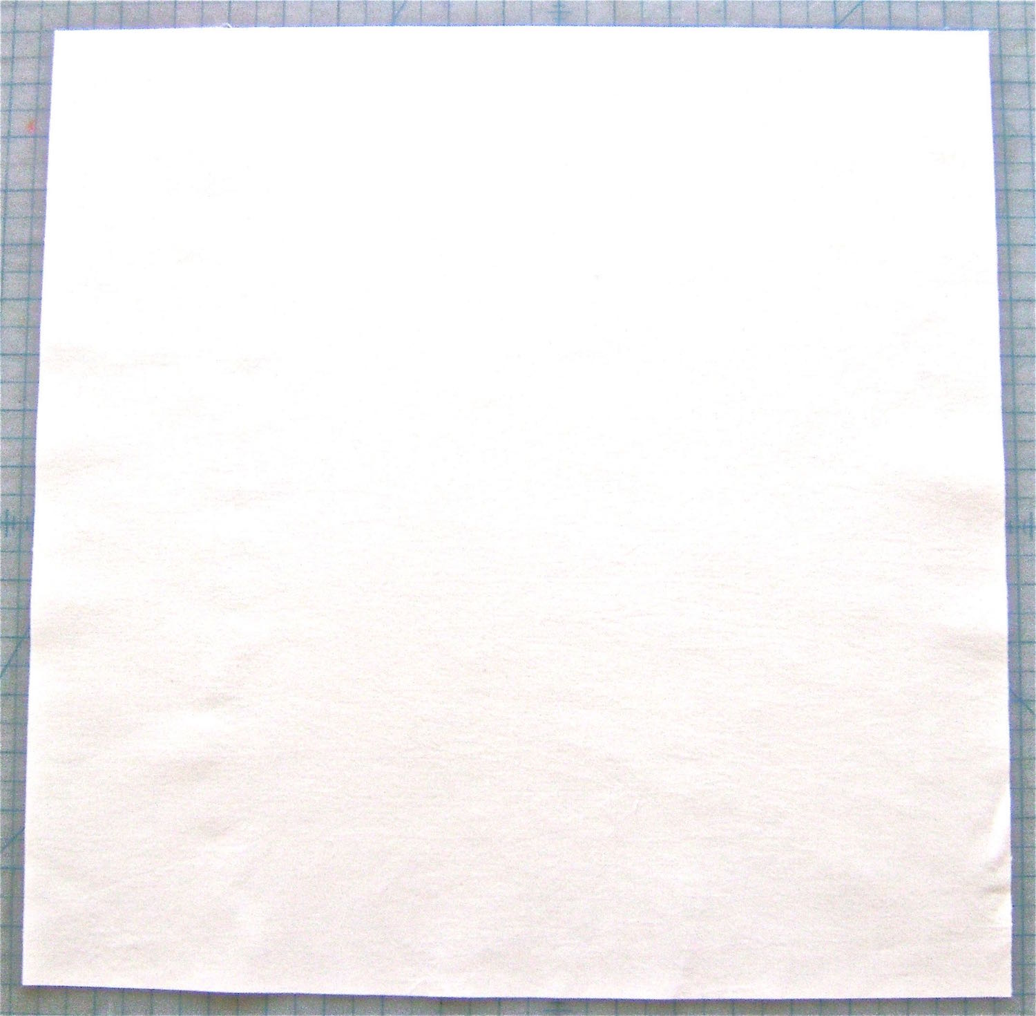 """step 1 - Cut the peach fabric into a 17"""" square. Iron fusible interfacing on the wrong side."""