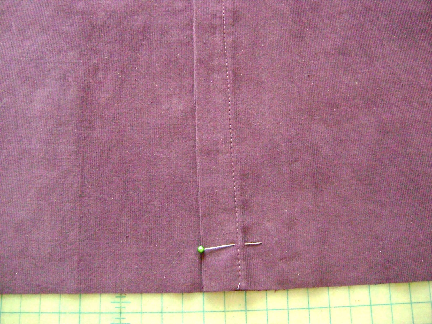 """step 17 - Overlap the two pieces so that they measure 17"""" across. There should be approximately 3"""" of overlap. The 8.5"""" piece should be on top. Stitch on the existing hemline one inch in from the raw edge on both ends of the opening."""