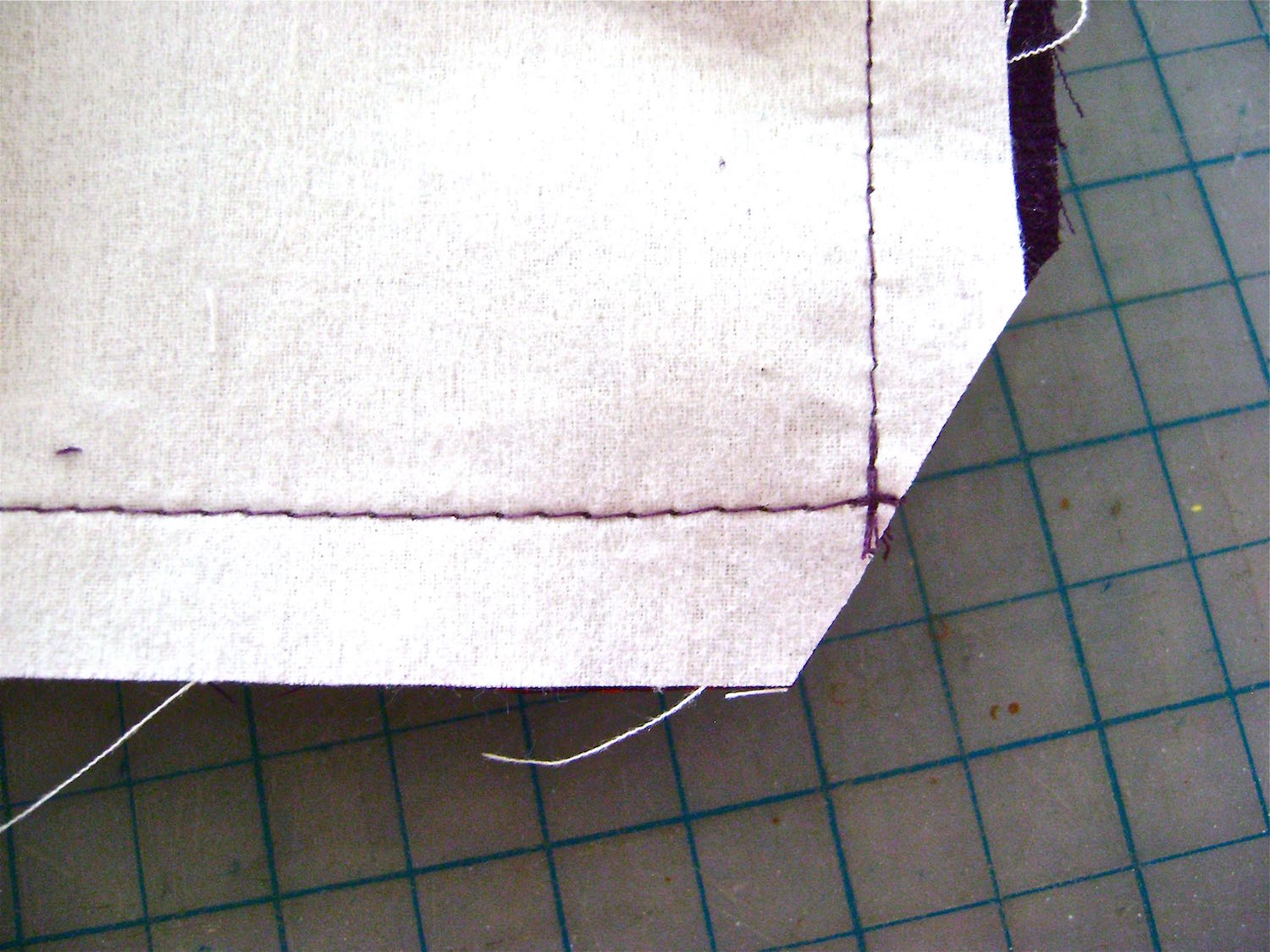step 19 - Remove excess fabric at the corners but trimming them at an angle.