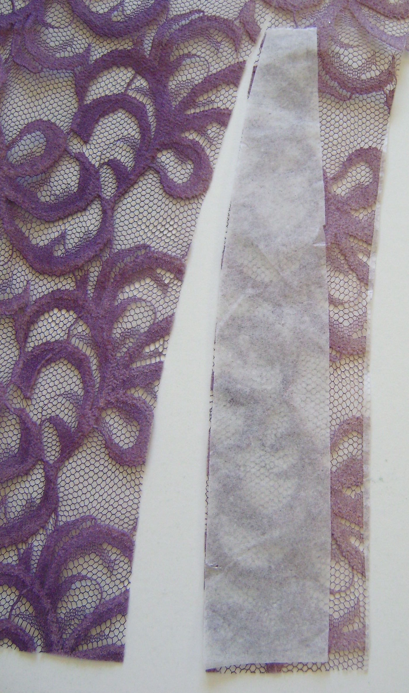 """step 4 - Following your pattern, cut out 12 pieces of lace making them ½"""" longer than the pattern. Spray the backsides of the cut pieces with adhesive."""