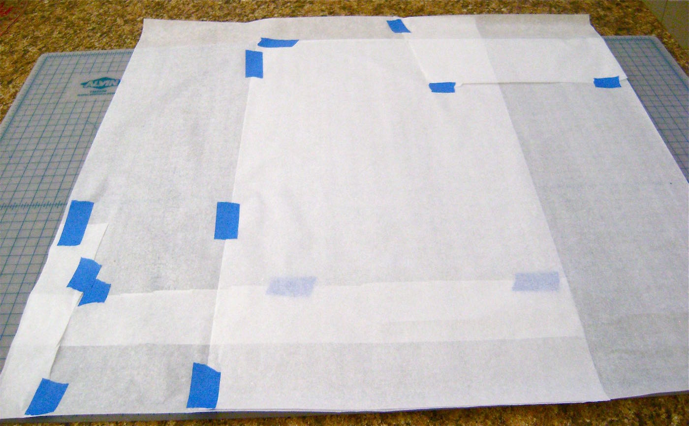 """step 1 -  The Pattern   Create a 27"""" square from gift-wrap tissue paper or other handy materials. Piece the paper together with painters tape."""