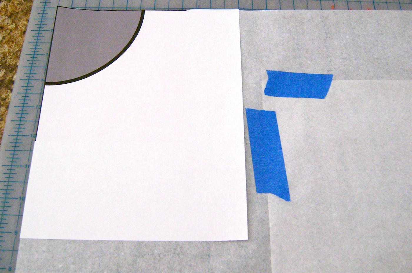 step 2 - Download and print out the quarter circle template. Match the corner of the template with the corner of the paper square.