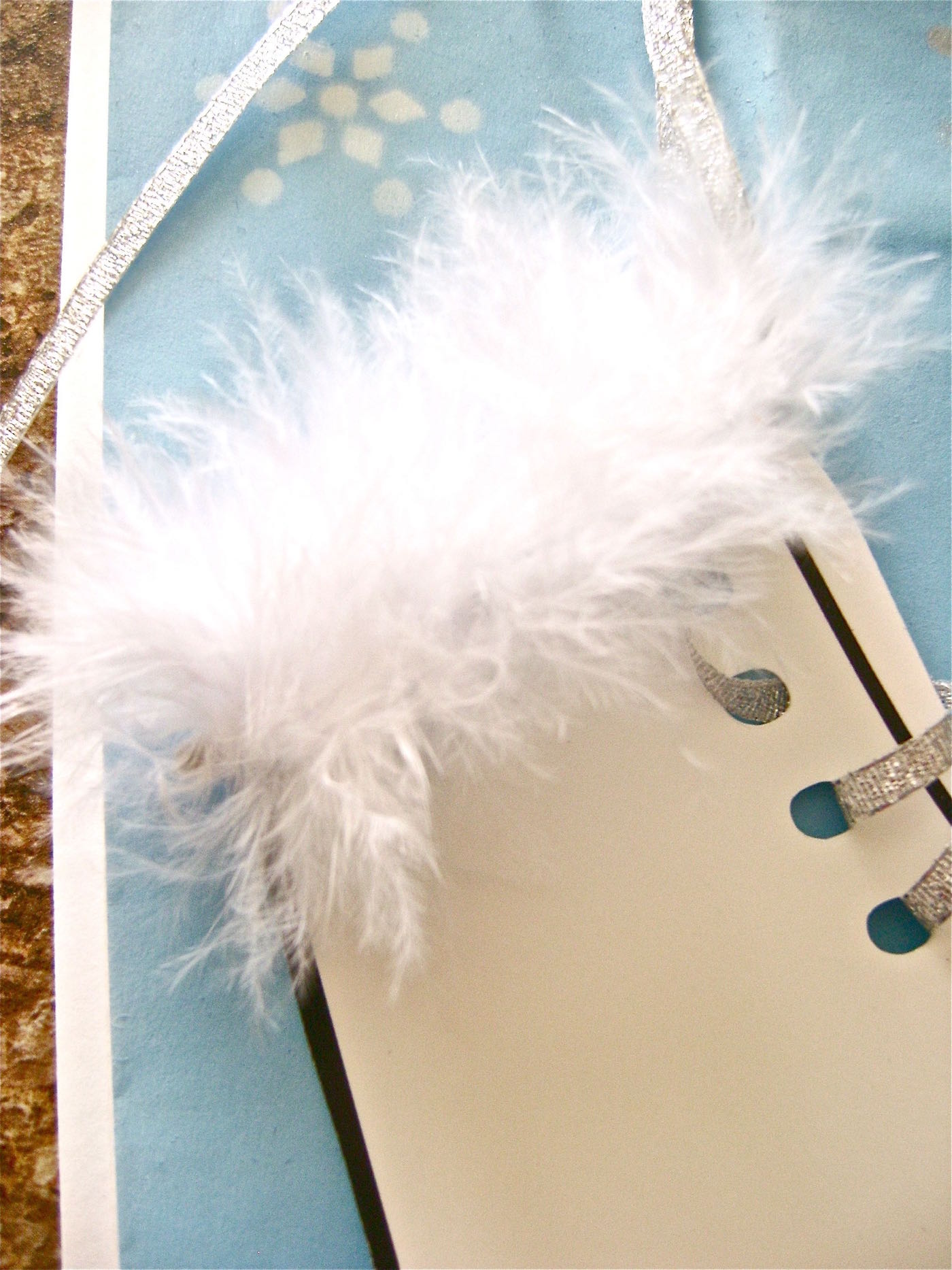 """step 12 - Put down a bead of glue on the bag above the skate and attach a 2.25"""" strip of white boa to the glue."""
