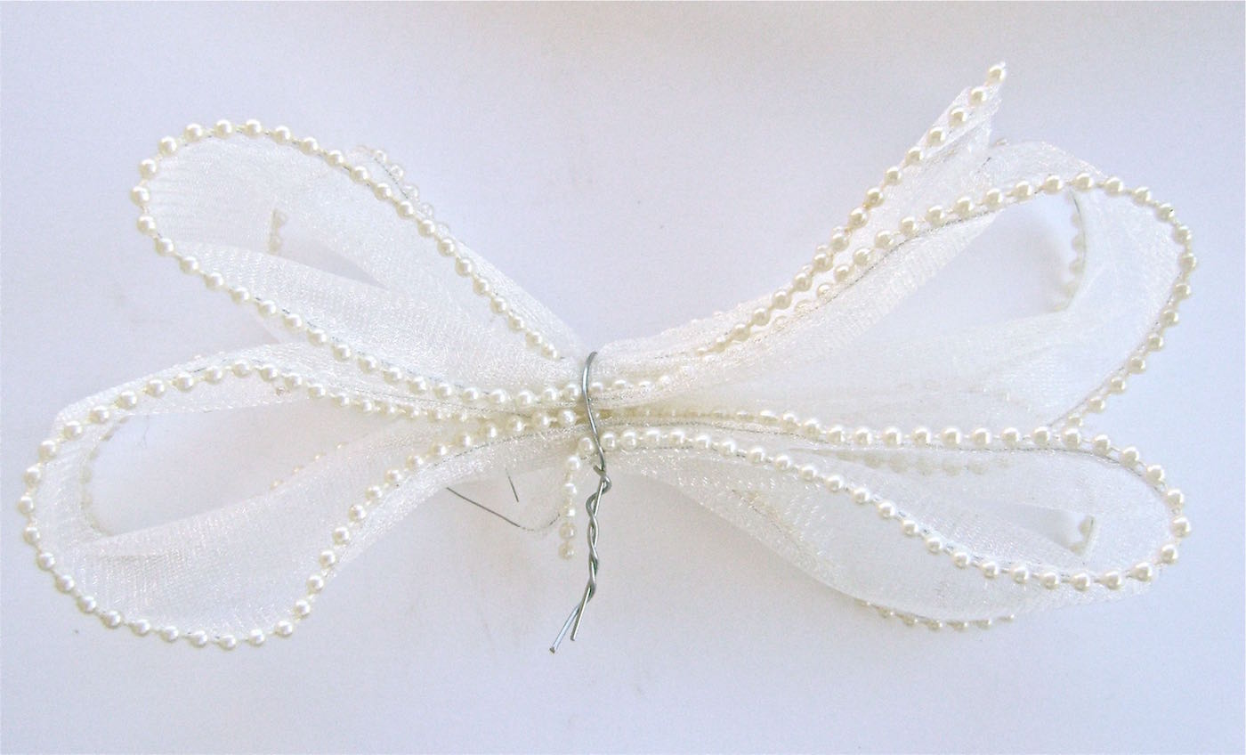 "step 10 - Create the bow by making four loops with one piece of ribbon.  Secure the bow with wire, twisting the ends together.  Leave a 2"" tail of ribbon."