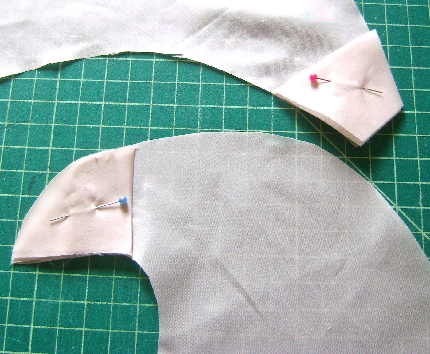 """step 3 - Trace the fabric ends onto folded pieces of scraps to create facings for the top and bottom ends. They should be 2.50"""" deep. Iron one layer of sturdy fusible interfacing inside the folded facings. This will give added strength and support especially for the top eyelet to be attached in step 6."""