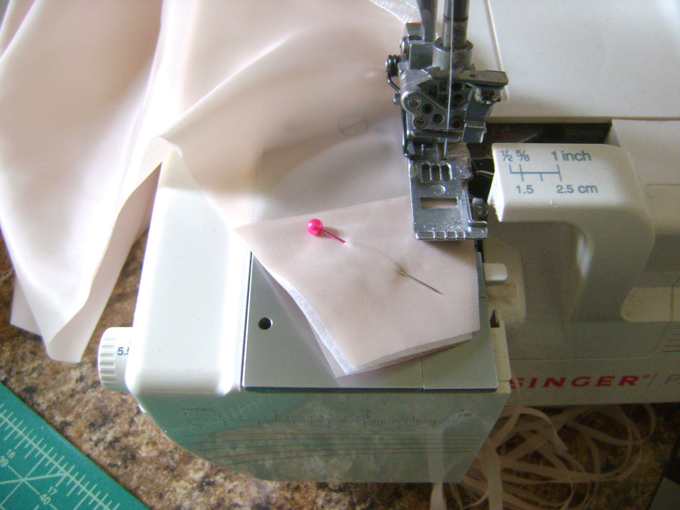 step 4 - Pin facings to the right side of the fabric. With a close stitch, serge or zigzag from the top end all around the outer edge until you reach where you started, catching the facings in the stitching. Do the same with the second fabric panel.