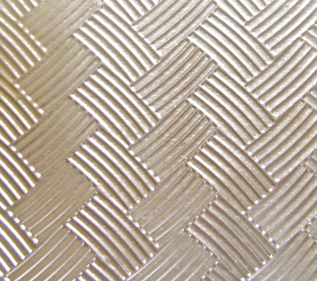 "step 2 - Emboss a piece of foil that measures 3.5"" square. A disposable oven pan lid is the material used for the shiny metal basket.  With scissors, cut a piece to measure 3.5"" square and place it into a Darice basket weave embossing folder. I don't own an embossing machine so I placed the foil in the folder and ran it through my clay conditioning machine on the number two setting.  It does the job."