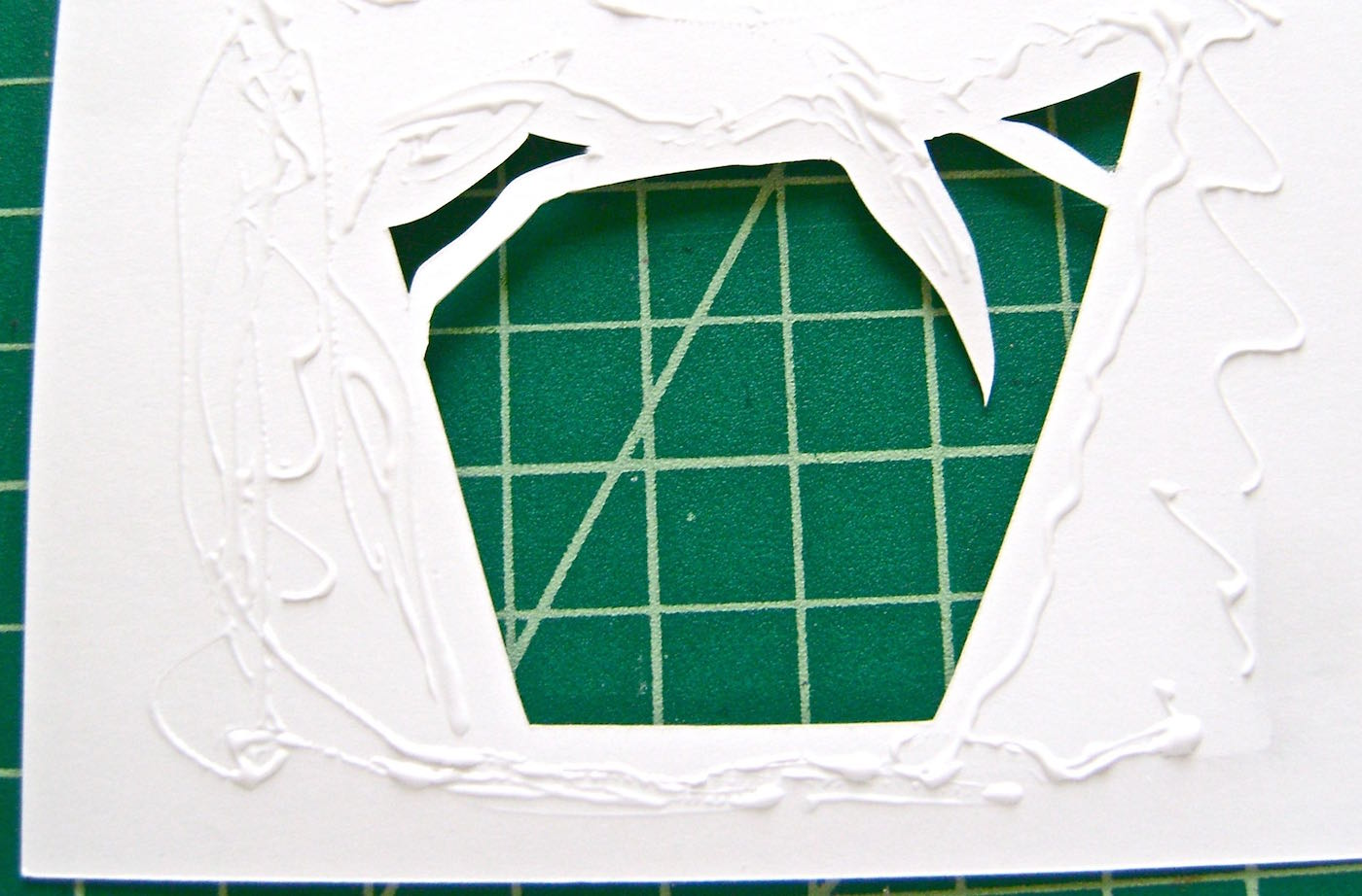 step 3 - Apply Aleene's Turbo Tacky glue to the wrong side the card front and close to the cut edges.  Press the foil to the glue.