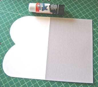 step 4 - Use the glue stick to attach the liner to the wrong side of the template, aligning the bottom edges.