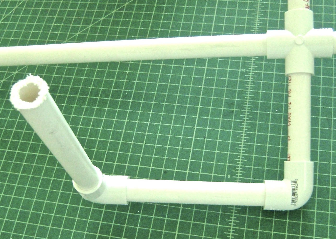 step 7 - Use elbow connectors to attach the arms.  They will allow you to position the upper and lower arms.