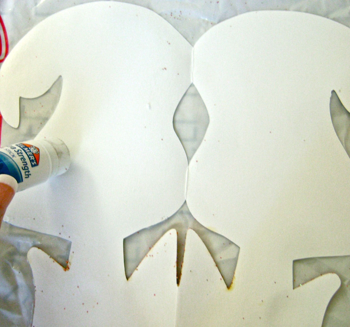 step 7 - Using a glue stick, run around the outer edge of one ghost on the blank side. Also apply glue along the fold.
