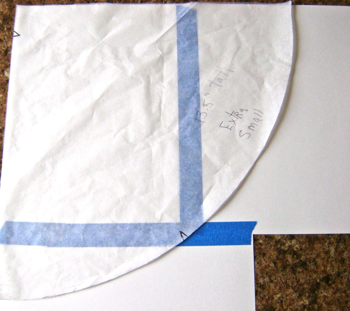 step 1 - Using Cyndy's template, cut out a cone using regular card stock. Piece together enough card stock with tape to create a page large enough to fit the size of your cone. My cone size is extra small and it required three sheets of card stock.