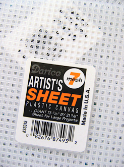 step 1 - Place a sheet of plastic canvas on your work surface.