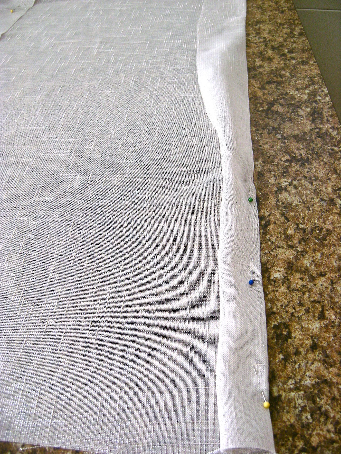 step 3 - Fold the raw edges into the pressed crease on each side then press in place.