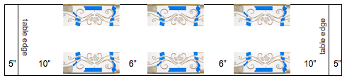 """step 8 - For my 6.5' long table, I used three images per side with 6 inches in between each, and 15"""" on each end. That allowed me a 5"""" drop on the ends. I also didn't want the first image at the very edge of the table so there's a 10"""" blank space from the table edge to the first image.  To place three images on a side, fold the hemmed runner in half and place a pin in the center fold. Place the center of the stencil on the pin and the edge of the card stock against the edge of the fabric. Determine how much space you have to the left and right of the stencil and position your images accordingly. Don't forget to allow for the drop.  If you don't have room for three images per side, you can instead, plan two on each side. Fold the hemmed runner in half and center the stencil on each half."""