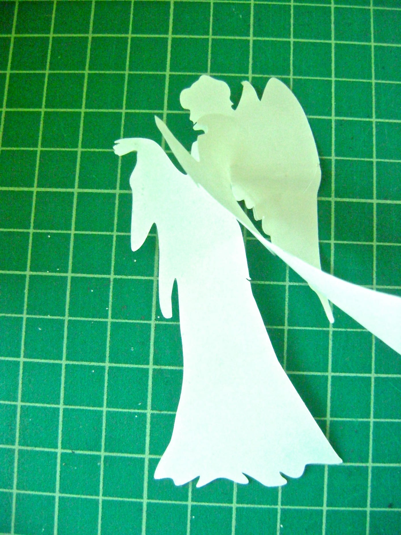 step 2 - Use a craft knife to cut out the stencil. It's not necessary to cut out the halo. It's only provided as a guide for the wire halo size and placement later. Peel away the backing from the positive stencil image.