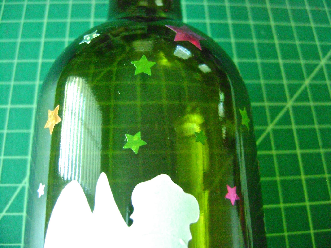 step 4 - Arrange star stickers in a variety of sizes on the bottle.