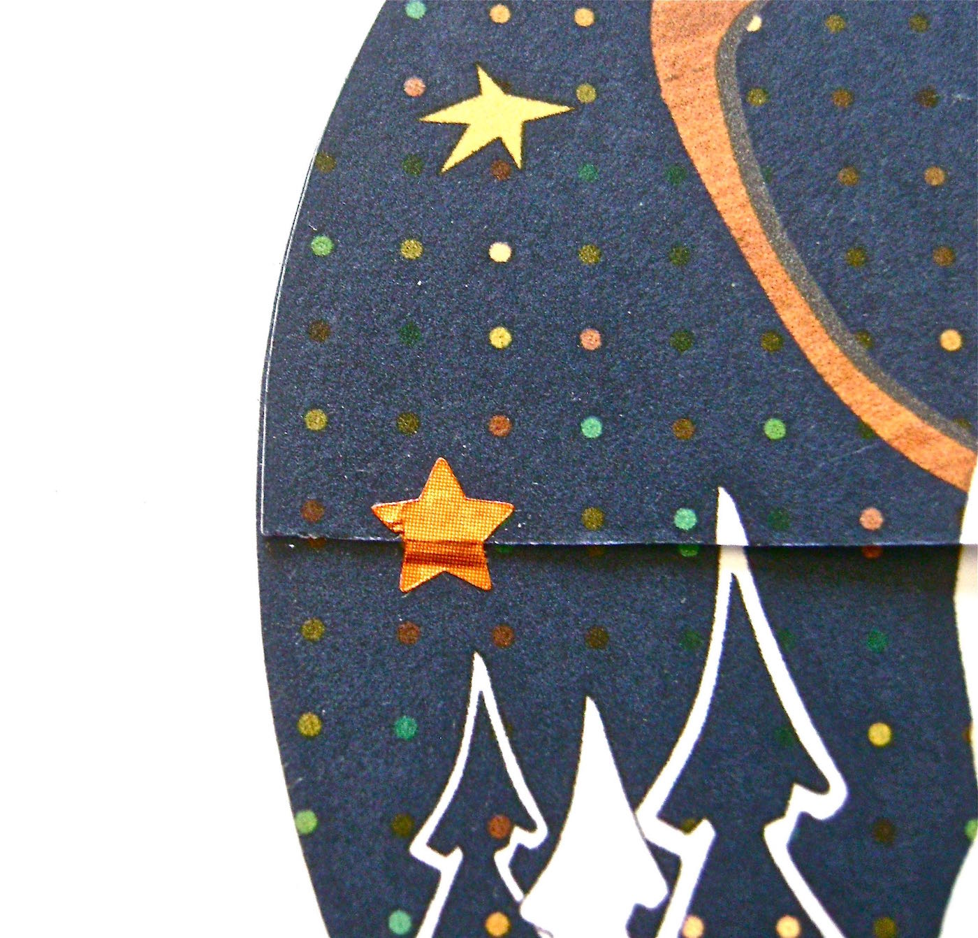 step 11- Insert a gift card in the holder. Close the flap and secure it with a star sticker on the right and left flap edges.