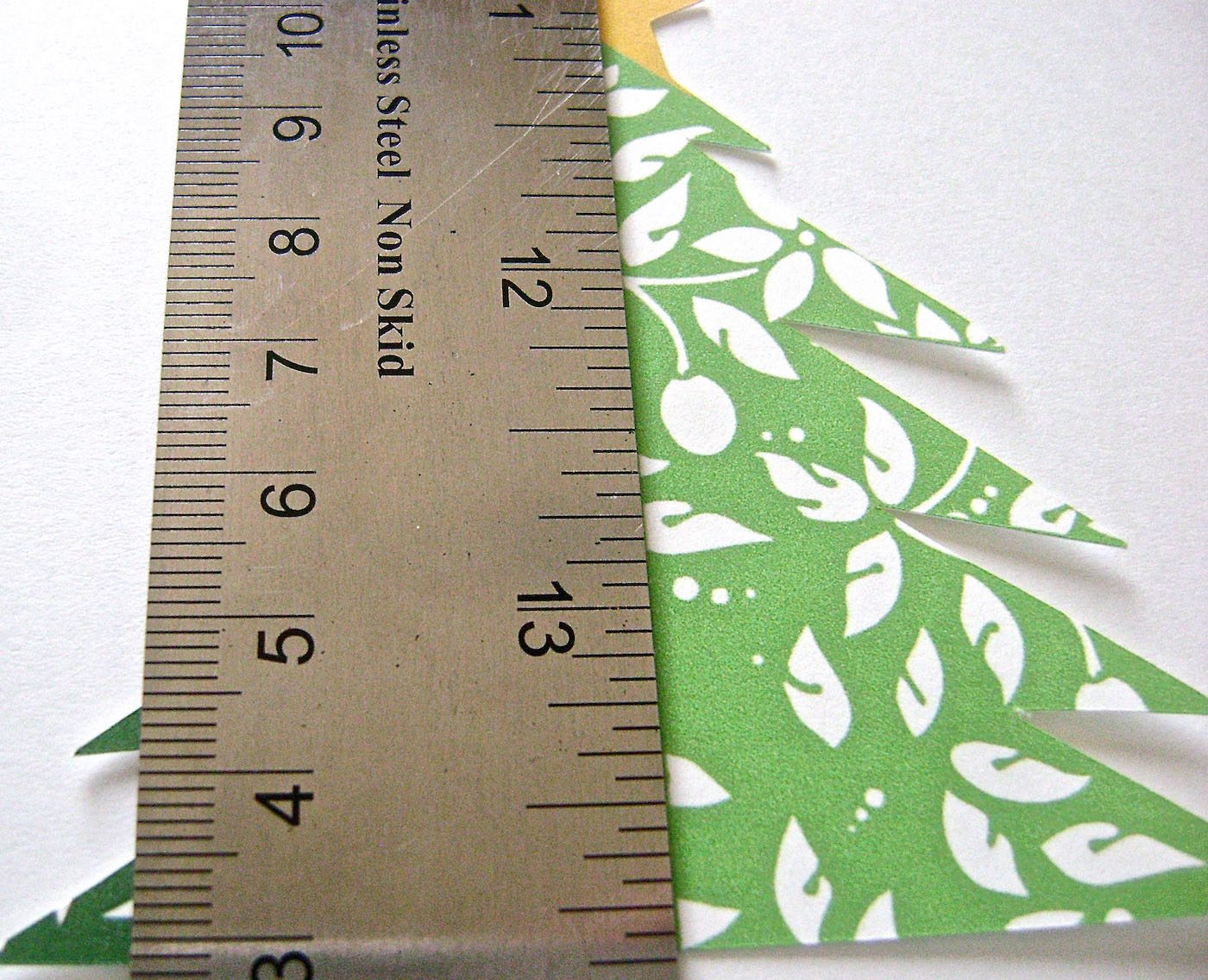 step 2 - Place a sharp edge ruler in the center of each tree.