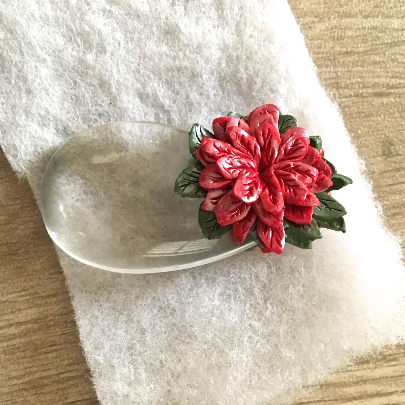 """12. Place the ornament on a soft cushioned surface like fiberfill. It will """"nest"""" the ornament and not leave a shiny finish on the clay. Bake the piece at 275 degrees for 30 minutes."""