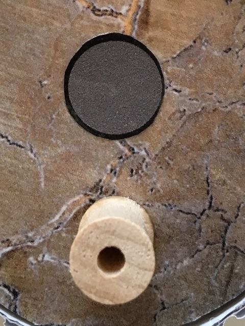 """step 15 -Print out a .50"""" gray circle with a black outline for each house. Glue them to the upper portion of each. Hot glue a miniature thread spool below the circles. Apply a thin coat of Diamond Glaze to the houses with a soft brush if a gloss is desired."""