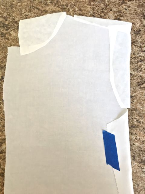 step 3 - Cut out the left front fabric piece, the collar, and the cuffs for your shirt. Place adhesive stencil vinyl on the backside of the fabric to stabilize it while sketching and painting. Cover any exposed sticky areas with freezer paper.
