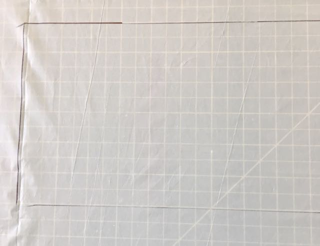 step 1 -    Cover your work surface with plastic. Determine how much fabric space will be filled with color and mark off an area slightly larger than that on the plastic with a Sharpie.