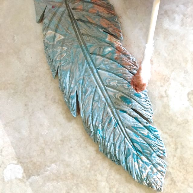 step 16 - Use a Q-tip to apply copper mica powder unevenly to the edges of the feather and the center line.