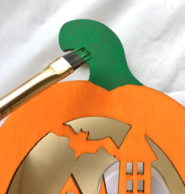 step 7 - While waiting for the paint to dry, paint the pumpkin stem Green. Paint various parts of the project between adding more silkscreen designs.
