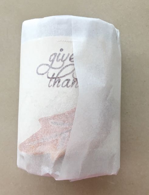 Step 18 - Wrap the parchment over the clay tucking in the excess on both open sides of the roll to hold it together.