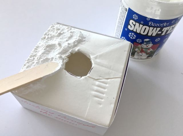 step 8 - Apply Snow-Tex to the flat surface of the base with a craft stick.
