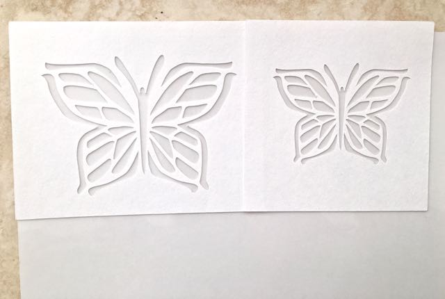 step 3 - Position the stencils on a sheet of Clear Sticker Paper.